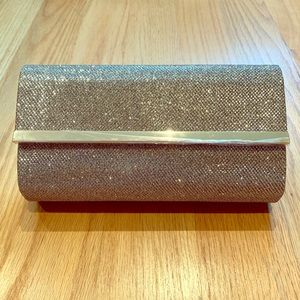 Gold glitter clutch by Bareminerals
